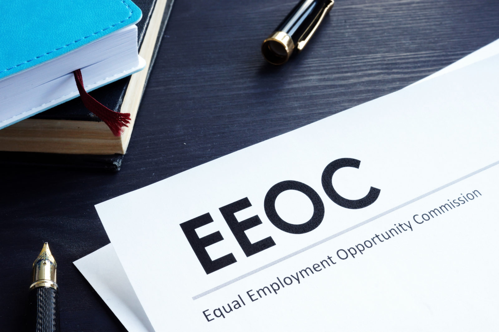 Equal Employment Opportunity Commission EEOC document and pen on a table.